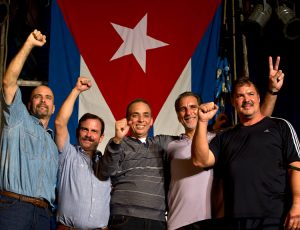 "Cuban Five in Havana, Dec. 20, 2014, after up to 16 years in U.S. prison. From right, Ramón Labañino, René González, Antonio Guerrero, Fernando González and Gerardo Hernández. They won freedom with support of the Cuban people and an international ""jury of millions."""