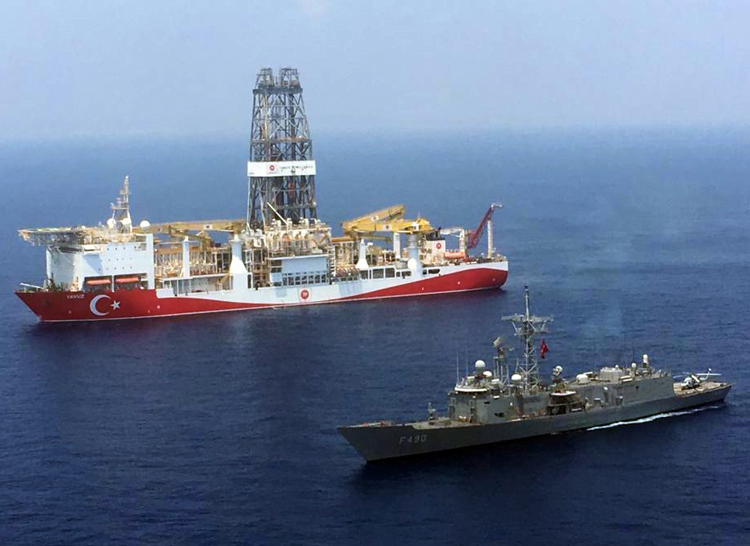 Oil driller escorted by Turkish naval frigate in eastern Mediterranean Aug. 6. Rebel forces led by Khalifa Haftar, backed by Cairo, Paris and now Moscow, have besieged the U.N.-backed government in Tripoli, armed by Turkey and Qatar, escalating oil-fueled civil war in Libya.