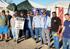 Members of Machinists Local 933 from Raytheon missile plant in Tucson brought donations to Asarco picket line at Mission Mine Dec. 20. Copper miners strike began Oct. 13.