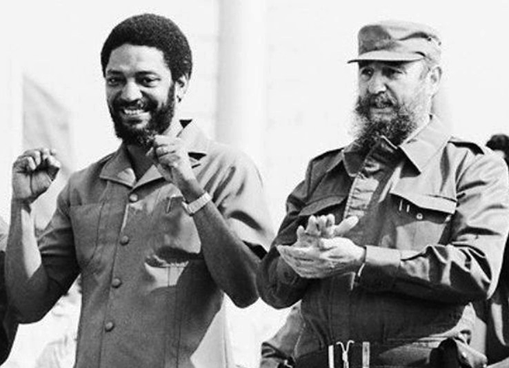 "Maurice Bishop, left, and Fidel Castro, 1980 May Day rally, Cuba. Castro said 1979 revolutions in Grenada and Nicaragua joined Cuba as ""three giants rising up on threshold of imperialism."""