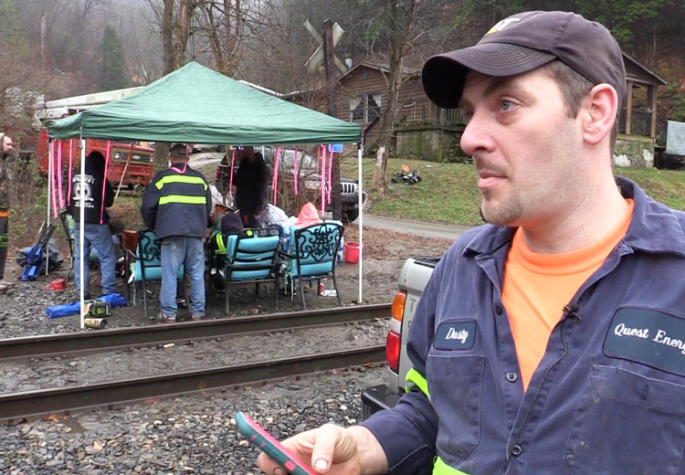 Coal miner Dustin Maynard, right, talks to press at miners' blockade of rail tracks outside Quest mine in Kimper, Kentucky, Jan. 14. Protest builds on earlier action at Blackjewel mine.
