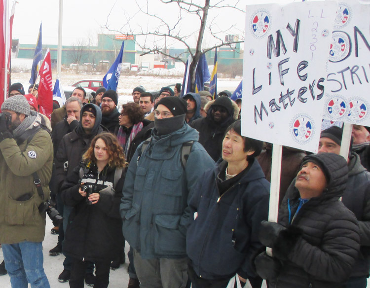 Aircraft refuelers in Quebec, on strike against Swissport Canada, and other unionists rally at company offices in Montreal Jan. 15 demanding higher pay and adequate on-the-job training.
