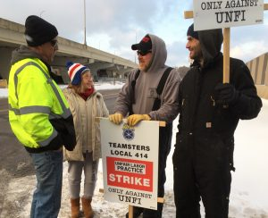 Teamsters Local 414 members, who struck United Natural Foods plant in Ft. Wayne, Indiana, picket at company's Hopkins, Minnesota, plant Dec. 17, winning support from workers there.