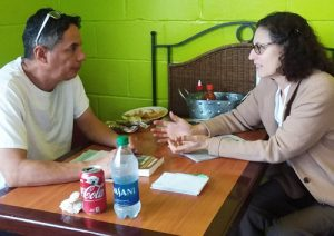 """Rachele Fruit, SWP candidate for U.S. Senate from Georgia, speaks with Alejandro Mendez in Eatonton, Georgia, Jan. 11. """"It's working people who fight and die in U.S. wars,"""" he said."""