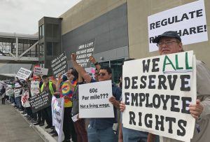 "Uber and Lyft drivers picket Los Angeles airport May 8, 2019, demanding to be treated as workers, not con-tractors. To win, SWP says, fight is needed to organize ""one union for all drivers."""