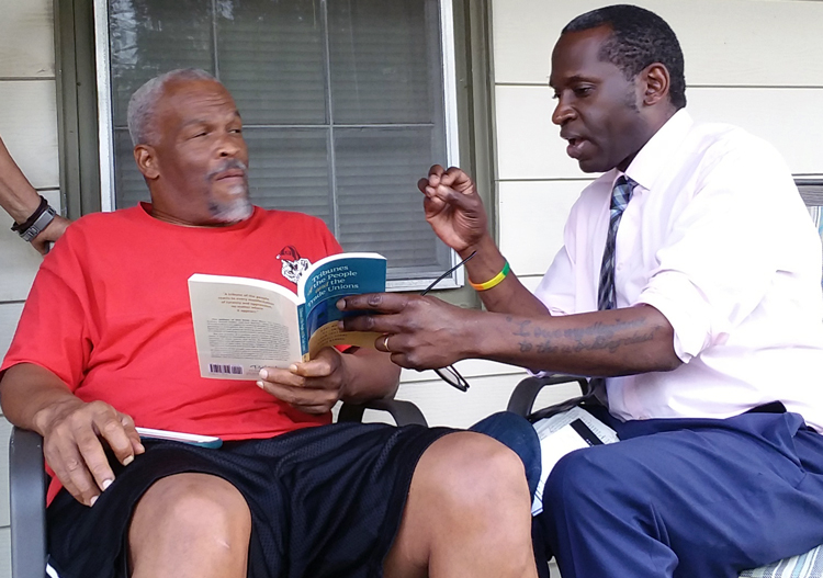 Malcolm Jarrett, right, SWP candidate for vice president, visits Reggie Jackson in Hogansville, Georgia, Oct. 1. Jackson got campaign book <em>Tribunes of the People and the Trade Unions.</em>