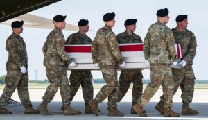Dissatisfaction among working people over declining wages, conditions, impact of rulers' wars fuels crisis in Democratic and Republican parties. Above, remains of GI killed in Afghanistan arrive at Dover Air Force Base, Delaware, July 2, 2019.