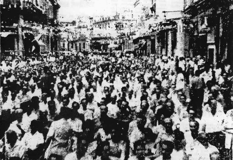 "Above, mobilization in Havana's Chinatown on the 11th anniversary of Chinese Revolution, October 1960, as Cuban toilers were expropriating domestic and imperialist capital. Inset, laundry worker, Havana, 1940s. ""Absence of anti-Chinese discrimination today,"" Mary-Alice Waters points out, is product of Cuba's socialist revolution."