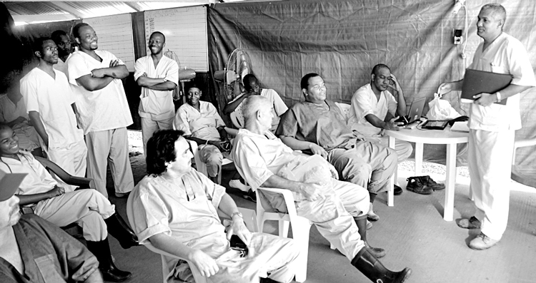 "Cuban doctors and Guinean staff at shift change at the Coyah treatment center in Guinea, January 2015. ""As they reported for duty, Cubans always made jokes,"" writes Ubieta. ""It lifted their spirits and those of patients and colleagues."""