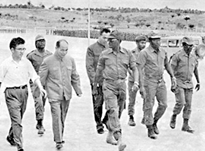 Angola, 1975 or '76: Chinese advisers at camp of Angolan guerrillas allied with apartheid South Africa and Washington. Some 425,000 Cuban internationalists volunteered to aid Angolan freedom forces battling South African invasions between 1975 and 1991. Beijing aided reactionary forces commanded by Holden Roberto (center, in sunglasses) and group headed by Jonas Savimbi on opposite sides of barricades from Cuba's revolutionary leadership.