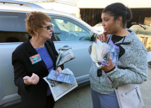 SWP presidential candidate Alyson Kennedy and nurse Christina Ware talk near San Leandro housing complex where residents are fighting landlord's moves to nearly double their rent..
