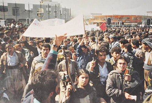 Mass Kurdish uprising in Duhok, northern Iraq, in 1991. Three years earlier, Iraqi regime of Saddam Hussein, with U.S. rulers' help, used chemical weapons to massacre Kurds in Halabja.