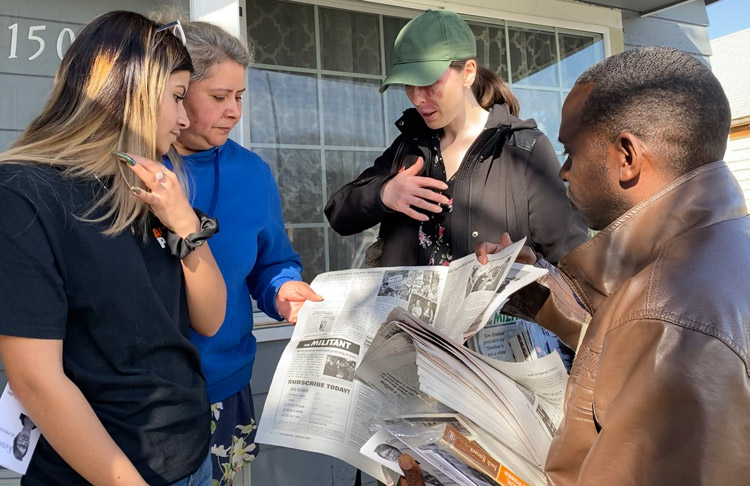 From right, SWP candidates Malcolm Jarrett for vice president, and Rebecca Williamson for Congress, speak with Heidi Gomez and mother Susana, a farmworker, in Yakima March 3.