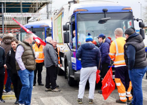 Sanitation workers, members of Unite union on strike in south-east London, stop refuse truck March 18. Two-day walkout won sick pay. Workers are also demanding end to multitier wages.