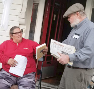 Larry Quinn meets Rosanna Burgess on her porch in Troy, N.Y., last Sept. 13, campaigning as SWP candidate for City Council president.