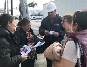 "Pedro Albarran (with hard hat), Farmer John worker and union leader there, introduces SWP presidential candidate Alyson Kennedy to co-workers during plant gate campaigning Feb. 28. He told them that Kennedy and running mate Malcolm Jarrett ""are workers like you and me."""