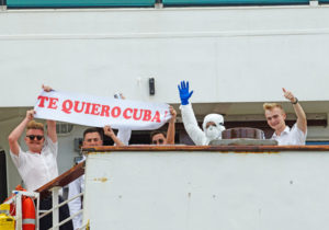 """MS Braemar crew members hold sign, """"I love you Cuba,"""" after Cuban government let ship dock March 18 with passengers with coronavirus, after other Caribbean nations denied it entry."""