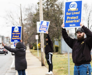 Workers, members of Communications Workers of America, protest outside General Electric jet engine plant in Lynn, Massachusetts, March 30, demanding GE urgently convert production to life-saving ventilators, not lay off thousands of assembly line and maintenance workers.