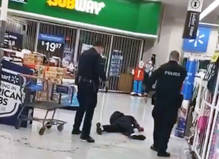 Cops stand over dying Steven Taylor after shooting and using Taser on him at San Leandro, California, Walmart April 18. Family has demanded cops be arrested and prosecuted. Inset, photo of Taylor.