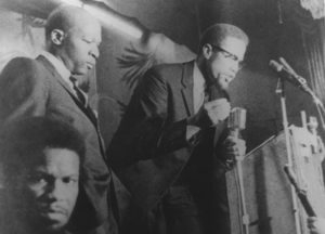 Malcolm X speaking at Audubon Ballroom in Harlem, New York, Feb. 15, 1965, giving speech that is excerpted here. He was assassinated when he spoke at the ballroom six nights later.
