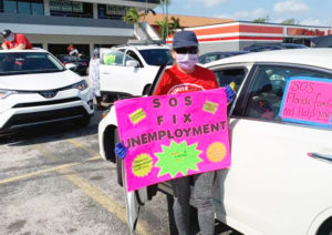 "Miami hotel, restaurant workers idled by government shutdown joined union car caravan April 19 to protest unemployment pay delays. ""The system doesn't work,"" Ines Santiesteban said."