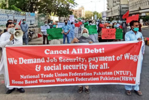 Factory, textile and garment workers demonstrate in Karachi, Pakistan, April 18, demanding end to firings by bosses, for payment of wages for workers at plants that are shut down.