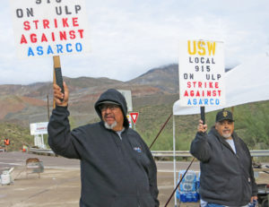 Striking copper miners picket Asarco's Ray Mine in Arizona.