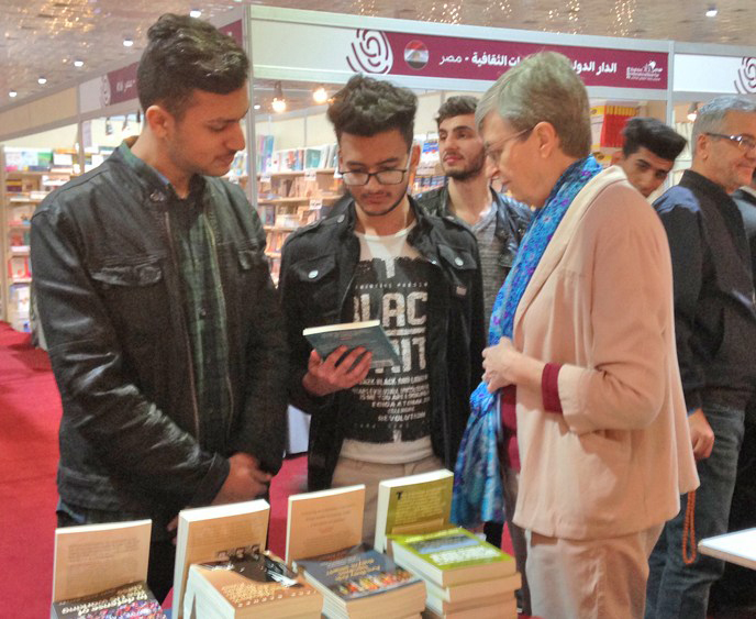Catharina Tirsén discusses books by SWP leaders with Iraqi youth at February 2019 Baghdad International Book Fair.