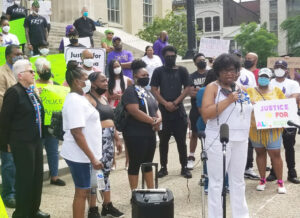 Some 200 people rally May 26 at mayor's office in Louisville, demand cops who shot Breonna Taylor as she lay in her bed be arrested. With mic is Velicia Walker, mother of Kenneth Walker, Taylor's boyfriend. Maggie Trowe, left, SWP candidate for U.S. Senate, also spoke.