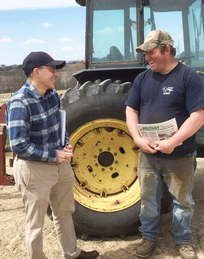"David Rosenfeld, left, SWP candidate for Senate in Minnesota, and Darin Von Ruden, president of Wisconsin Farmers Union, on Ruden's farm. Von Ruden subscribed to Militant, purchased Red Zone: Cuba and the Battle Against Ebola in West Africa. ""Capitalism doesn't work well for health care, food,"" he said."
