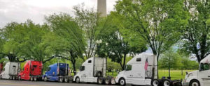 """Truckers' rigs parked near Capitol in Washington D.C., May 1, after rolling """"Mayday"""" protests over squeeze between rising costs and cuts of up to half in payments by brokerage companies, exploiting truckers' competition for freight jobs."""