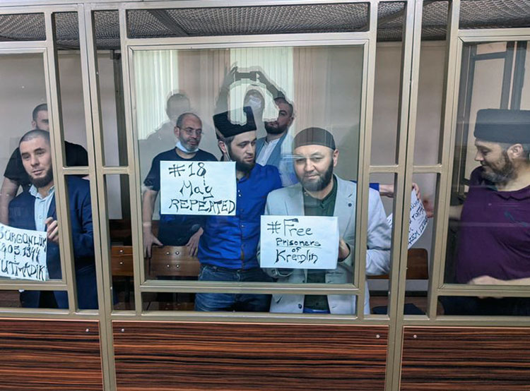 Following Moscow's 2014 occupation of Crimea, Crimean Tatars are prohibited from holding events to commemorate 1944 deportation of entire Tatar population from peninsula. On May 18, Tatar prisoners defied ban and staged protest at frame-up military court hearing in Russia.