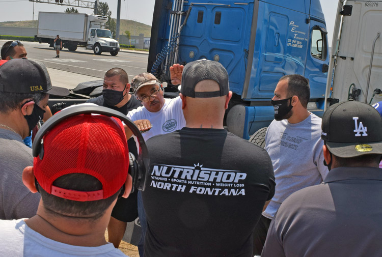 Driver Jose Gonzalez addresses fellow independent truckers in Fontana, California, during protest against brokers driving down their wages and anti-worker government regulations.