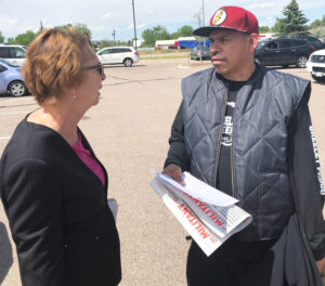 "SWP presidential candidate Alyson Kennedy speaks with Angel Bernal during shift change at JBS meatpacking plant in Greeley, Colorado. ""Slowing down line speed should be permanent,"" Kennedy said. ""Workers need to take control of production to ensure safe working conditions."""