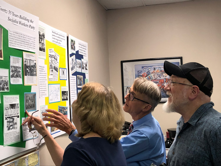 Participants in May 30 Atlanta meeting look at displays showing Cheryl Goertz's 55 years in building Socialist Workers Party. Inset, SWP leader Dave Prince addresses the meeting.