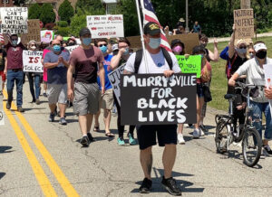 Several hundred march June 14 in Murrysville, Pennsylvania, one of thousands of protests in cities, towns and rural areas all across the country. Many involve youth new to protest actions.