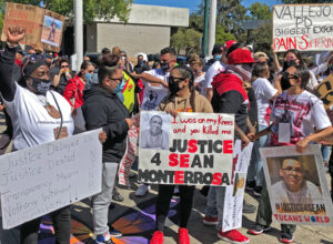June 13 action at police station in Vallejo, California, protests dozens of police shootings there in recent years. Latest victim, Sean Monterrosa, pictured on posters, was killed on June 2.