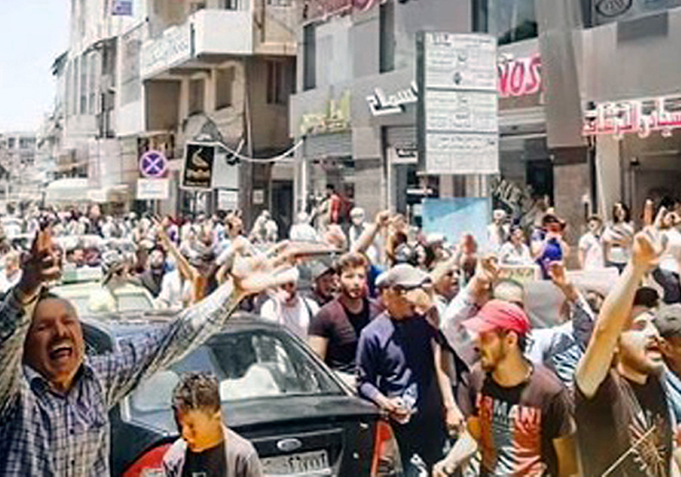 """Mainly youthful protesters in Suweida, southern Syria, June 7, chanted """"Get out Bashar,"""" and """"Syria is for us, it is not for Assad's family."""" They called for Russian and Iranian forces, which have propped up Bashar al-Assad's regime during brutal civil conflicts since 2011, to get out."""