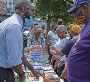 "SWP congressional candidate Willie Cotton, left, and SWP member Tamar Rosenfeld, wearing sign, talk with other participants at New York police brutality protest June 7. ""There's a thirst for books about Black struggle, women's emancipation, revolutionary history,"" Cotton said."
