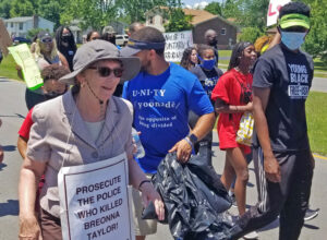 Alyson Kennedy, left, Socialist Workers Party candidate for president, joins more than 200 people marching against cop brutality in Radcliff, Kentucky, a town of 22,000, on June 13.