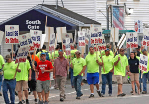 "June 22 picket at Bath, Maine, shipyard. Strike is solid and winning solidarity from other unionists and workers in the region in face of company's union-busting ""last and final"" offer."