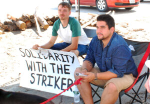 "Zak Larrabee, left, and Damon Ely, both from Boston, brought dozens of sandwiches to Bath shipyard strikers July 18, telling Militant their solidarity, and sandwiches, ""were well received."""