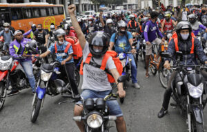 Thousands of motorcycle workers for Uber and other food delivery app employers protested July 1 in Rio de Janiero, above, Sao Paulo and other Brazilian cities in the largest action so far to resist bosses' use of high un-employment to pit workers against each other and drive down their pay and conditions.