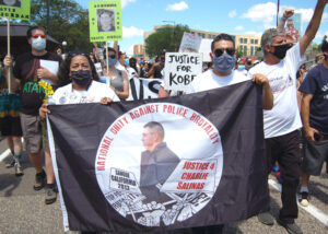"""""""The killings are not going to stop if we don't fight,"""" said Jennie Ruiz, sister of Charlie Salinas, shot down and killed by cops in Sanger, California, in 2012. Ruiz, left, holding banner, marched in National Mothers March Against Police Violence in St. Paul, Minnesota, July 12."""