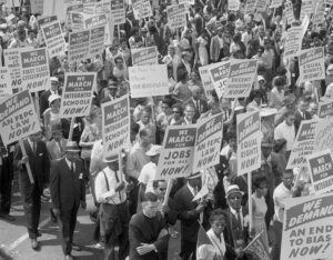 "1963 March on Washington for Jobs and Freedom, part of powerful Black-led working-class movement that overthrew Jim Crow segregation. Another product of this struggle was new Civil Rights Act passed the following year that outlawed employer discrimination in hiring, firing or promotion based on ""race, color, religion, sex or national origin."""