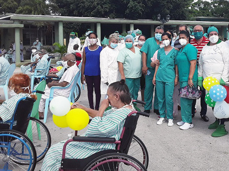 Celebration of end of coronavirus quarantine at senior citizens home in Santa Clara in early June. Cuban government took special measures to protect those most vulnerable to virus.