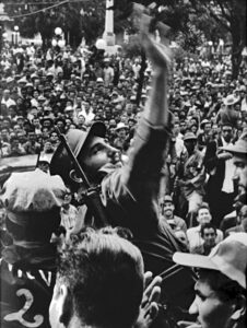 Fidel Castro is greeted by thousands of jubilant Cubans as his Freedom Caravan enters Santa Clara, Jan. 6, 1959, on the way to Havana after the revolution led by the July 26 Movement overthrew the U.S.-backed Fulgencio Batista dictatorship.