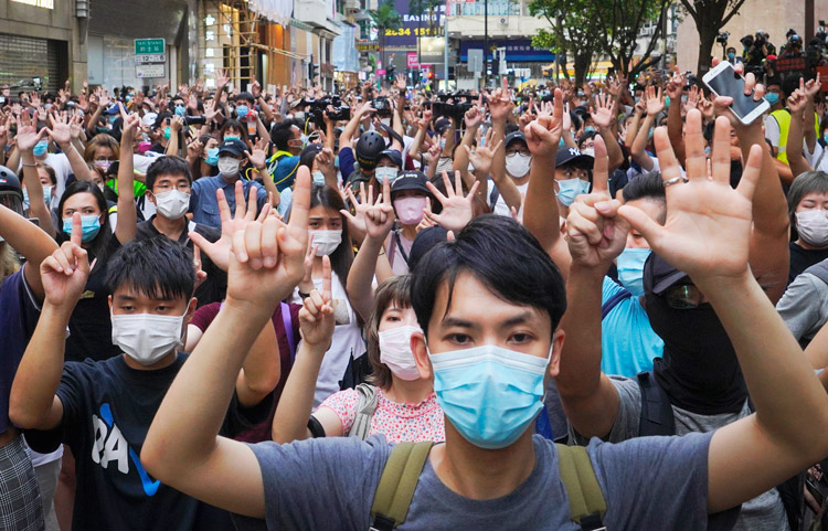 """In largest protest in Hong Kong this year, thousands rallied July 1 to commemorate 23rd anniversary of end of British colonial rule and reknitting of ties to China. Defying police attacks, they marched to press demands for political rights in opposition to new """"security"""" law imposed by Beijing."""