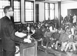 Malcolm X speaking to young people in Selma, Alabama, Feb. 4, 1965, during civil rights battle there. A month earlier, he addressed high-school-aged youth from Mississippi in Harlem. See for yourself, listen to what others say, he advised, but think and make your own decisions.