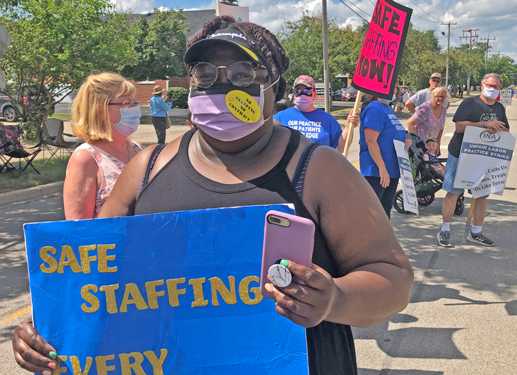 Striking Illinois nurses picket AMITA Health Center July 12 for better conditions, more staff.